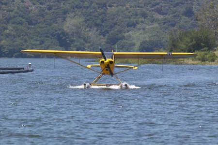 the amphibious: Yellow amphibious seaplane on Lake Casitas, Ojai, California