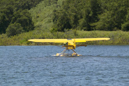 amphibious: Yellow amphibious seaplane taking off from Lake Casitas, Ojai, California