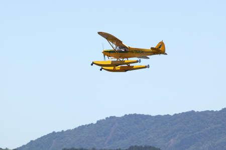 the amphibious: Yellow amphibious seaplane taking off from Lake Casitas, Ojai, California