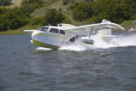 the amphibious: CB Amphibious seaplane taking off from Lake Casitas, Ojai, California Editorial