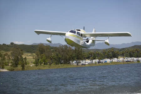 amphibious: CB Amphibious seaplane taking off from Lake Casitas, Ojai, California Editorial