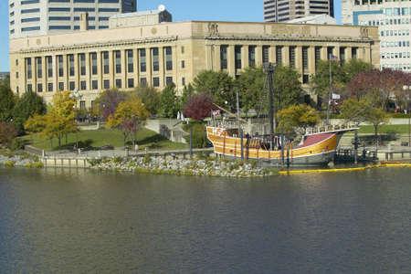 Replica of Columbus ship the Santa Maria on Scioto River, Columbus Ohio skyline in autumn