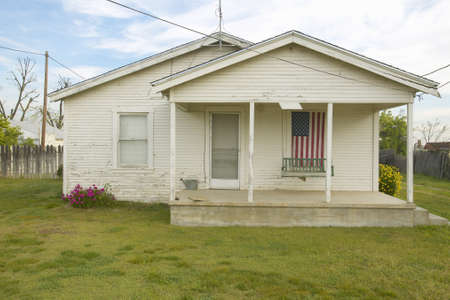 barstow: Old swing on porch displaying an American Flag and patriotic theme near Barstow CA off Route 58 Editorial