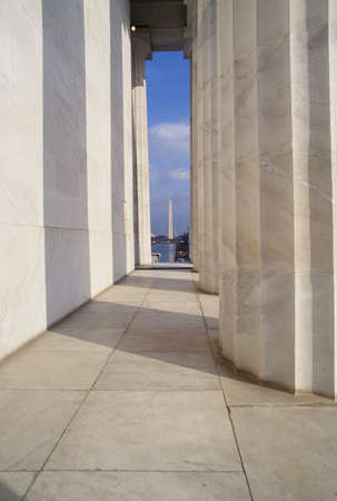 View of the Washington Monument through the pillars of the Lincoln Memorial, Washington D.C.