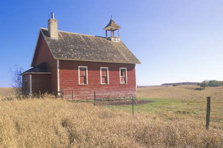 Old red schoolhouse on prairie, Battle Lake, MN
