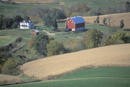 A farm with rolling fields near the Mississippi River in Northeast IA Stock Photo - 19995374
