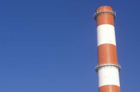 A red and white smoke stack at the Scattergood steam plant in Los Angeles, CA Stock Photo - 19994738