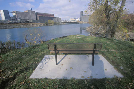 industrial park: A bench overlooking an industrial park on the Rouge River in Detroit, Michigan Editorial