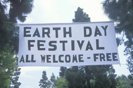 A hanging sign welcoming people to the Earth Day Festival Stock Photo - 19994754