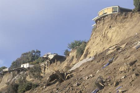 damaged roof: A home in Pacific Palisades, damaged in the Los Angeles earthquake of January 17, 1994, towering above part of its own roof and debris on a hillside  Editorial