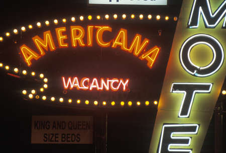 A neon sign that reads Americana Motel, vacancy