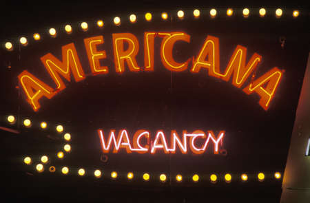 A neon sign that reads Americana, vacancy