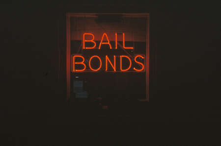 "A neon sign that reads ""Bail Bonds"""