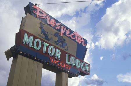 prospector: A neon sign that reads Prospector Motor Lodge, vacancy