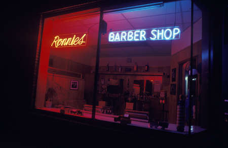 shop sign: A neon sign that reads Ronnies Barber Shop