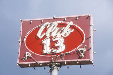 advertise with us: A neon sign that reads Club 13
