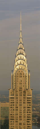 chrysler building: This is a close up of the Chrysler Building at sunset. It is the view from 42nd Street and 5th Avenue.