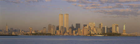 world trade center: This is the Manhattan skyline from New Jersey. It includes the Empire State Building, World Trade Towers, Statue of Liberty, and Brooklyn Bridge. Stock Photo