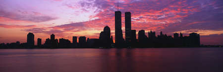 This is the Manhattan skyline from Jersey City, New Jersey at sunrise. The World Trade towers are in the center and the skyline is mostly in silhouette.
