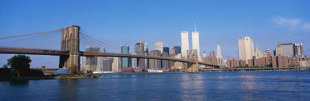 This is the Brooklyn Bridge over the East River with the Manhattan skyline.  photo