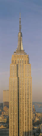 This is a close up of the Empire State Building at sunset. It is the view from 42nd Street and 5th Avenue. Editorial