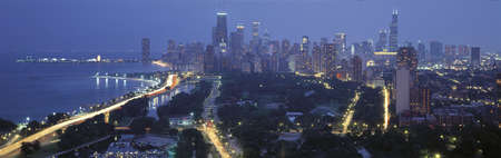 lake shore drive: This is the skyline with Lake Michigan and Lake Shore Drive on the left. It is the view from Lincoln Park at twilight in the summer.