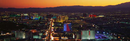 This is an aerial view of the strip showing an overview of the whole Las Vegas area at sunset. photo