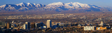 salt lake city: This is the State Capitol with the Great Salt Lake and snow capped Wasatch Mountains in morning light. It will be the winter Olympic city for the year 2002. Stock Photo