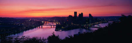 allegheny: This is sunrise on the Allegheny and Monongahela Rivers where they meet the Ohio River. This is the view from Mount Washington. Stock Photo