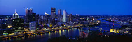 This is the Allegheny and Monongahela Rivers where they meet the Ohio River at dusk. This is the view from Mount Washington. Stock Photo - 20505061