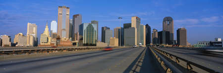 This is the freeway to the center of the city with the skyline in the background. The Chase Tower is the building in the center.  photo