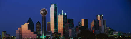panoramic: This is the skyline at dusk. It shows the Reunion Tower which is 50 stories high. Stock Photo