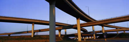 This is a freeway overpass intersection. It is the Interstate 10 & 15 in Southern California. The freeway criss-crosses over itself in several different directions.