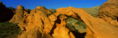 s shape: This is Nevadas first state park in red rock country. There is a sandstone arch that forms a window. It reveals a road that curves in a letter s shape.