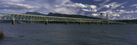 extensive: This is the Hood River Toll Bridge that crosses over the Columbia River. Mt. Hood is in the background. This is looking toward Oregon at the border. Stock Photo