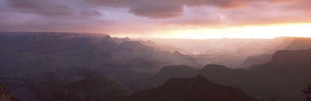 This is the south rim of the Grand Canyon known as Grand View Point.  Also in view is the Colorado River at sunrise. photo