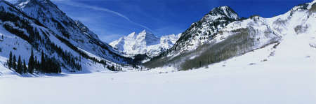 This is Pyramid Peak in the Maroon Bells after a winter snow storm. The altitude is 14,010 feet. photo