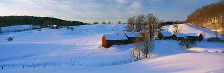 surrounding: This is the Jenne Farm at sunrise. The surrounding countryside is buried in snow. It is representative of New England in winter.