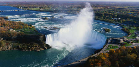 extensive: This is an aerial view of the Horseshoe Falls. It is the view from Skylon Tower in Canada.