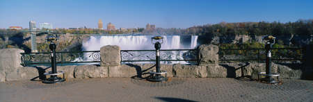 niagara falls city: This is the American Falls. There are viewing binoculars on the balcony in front of the falls. It was shot from the Canadian side.