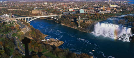 niagara falls city: This is an aerial view of the American Falls and Rainbow Bridge. It is the view from Skylon Tower in Canada.