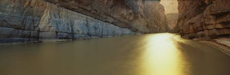 This is the Rio Grande River on the MexicoU.S. Border. It is located at Santa Elana Canyon. The river flows in between a limestone wall. photo