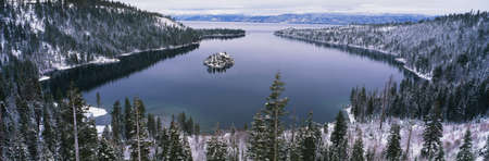 This is Emerald Bay after a winter snow storm. There is snow covering the ground surrounding the bay. photo