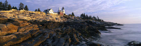 meets: This is the Pemaquid Point Lighthouse at sunrise. It was built in 1827. Below the lighthouse are the rocks that have been smoothed by the ocean wearing them down. The ocean lightly meets the bottom of the rocks at low tide.