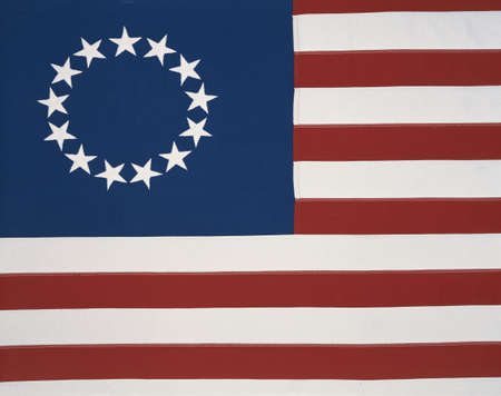 This is the original colonial flag with 13 stars representing the 13 original states at the time of the American Revolutionary War. The 13 stars are against a field of blue and the red and white stripes are sitting flat and move horizontally.