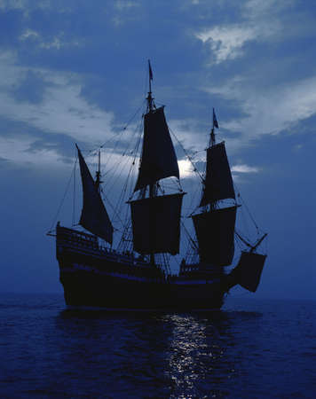 mayflower: This is a replica of the ship Mayflower II. It demonstrates the first sailing in 1620 when the Pilgrims sailed to the New World. The ship shows full sails on a shimmering moonlit ocean against a dark blue night sky.