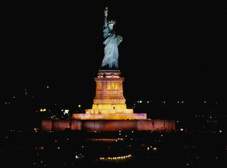 This is the Statue of Liberty lit up at night on Liberty Weekend. It was taken from the Aircraft Carrier Kennedy.