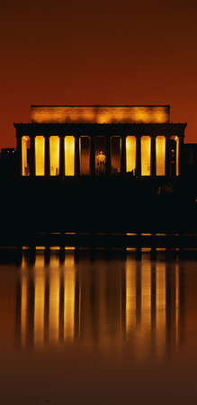 This is sunset at the Lincoln Memorial. An orange glow and reflection are shown in the reflecting pool in front of it.