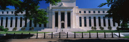 This is the Federal Reserve Bank, also known as The Fed where they make monetary policy. Its Federal Chairman is Alan Greenspan. It is an all white building with a green tree on either side of it.  Editöryel