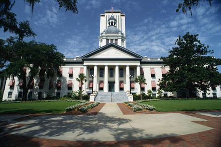 Tallahassee: This is the State Capitol building. It has a large concrete stairway leading up to it with large columns holding up the facade.